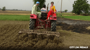 Foreigners enjoying the tractor ride in Amritsar Village Tour