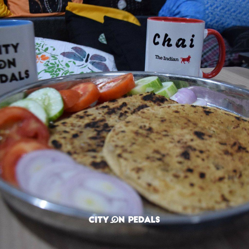 Traditional Punjabi breakfast - paratha, dahi and salad