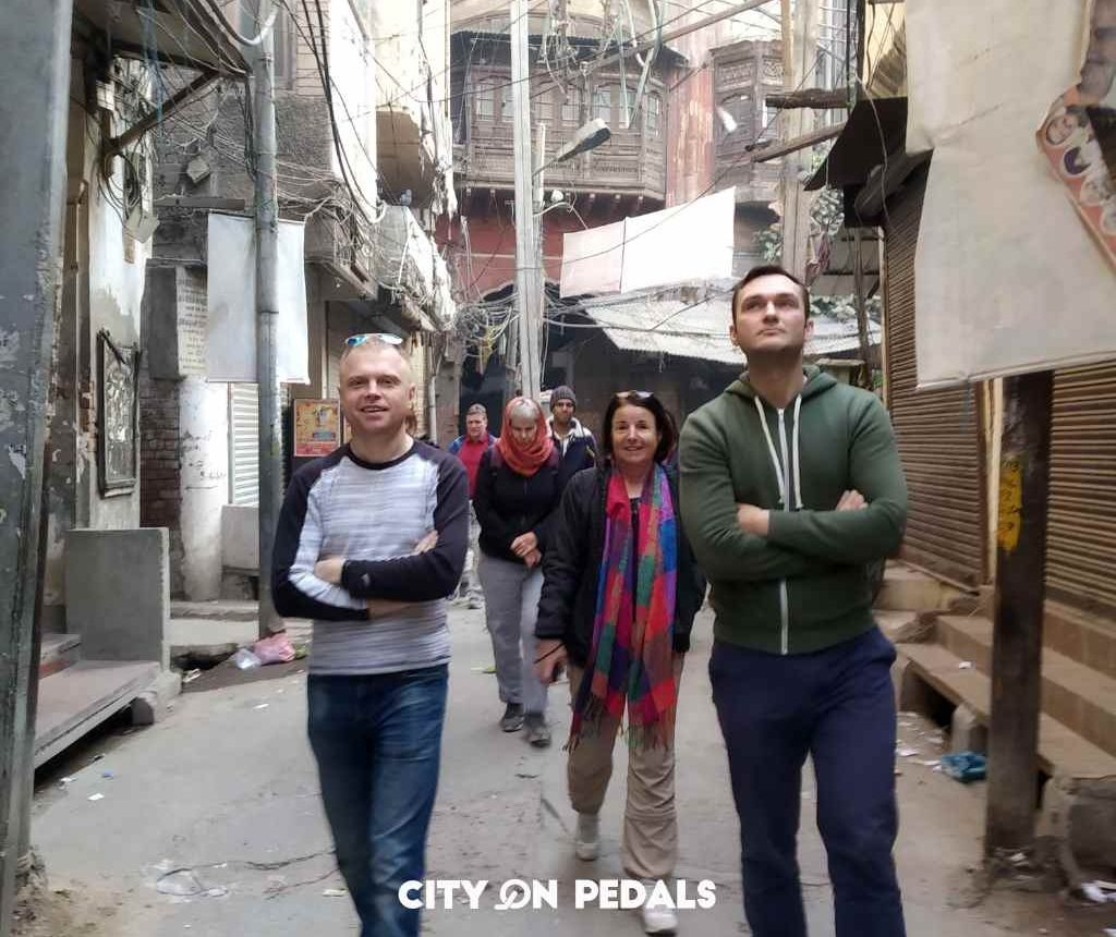 Group of travelers in the narrow lanes on the Amritsar Heritage Walking Tour
