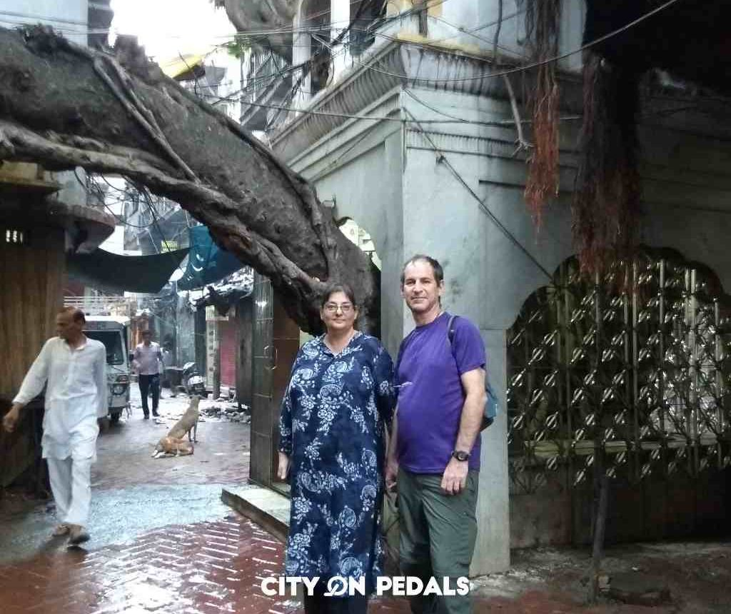 Couple taking a picture in front of Baba Bohar in the Bartan Bazar of old Amritsar