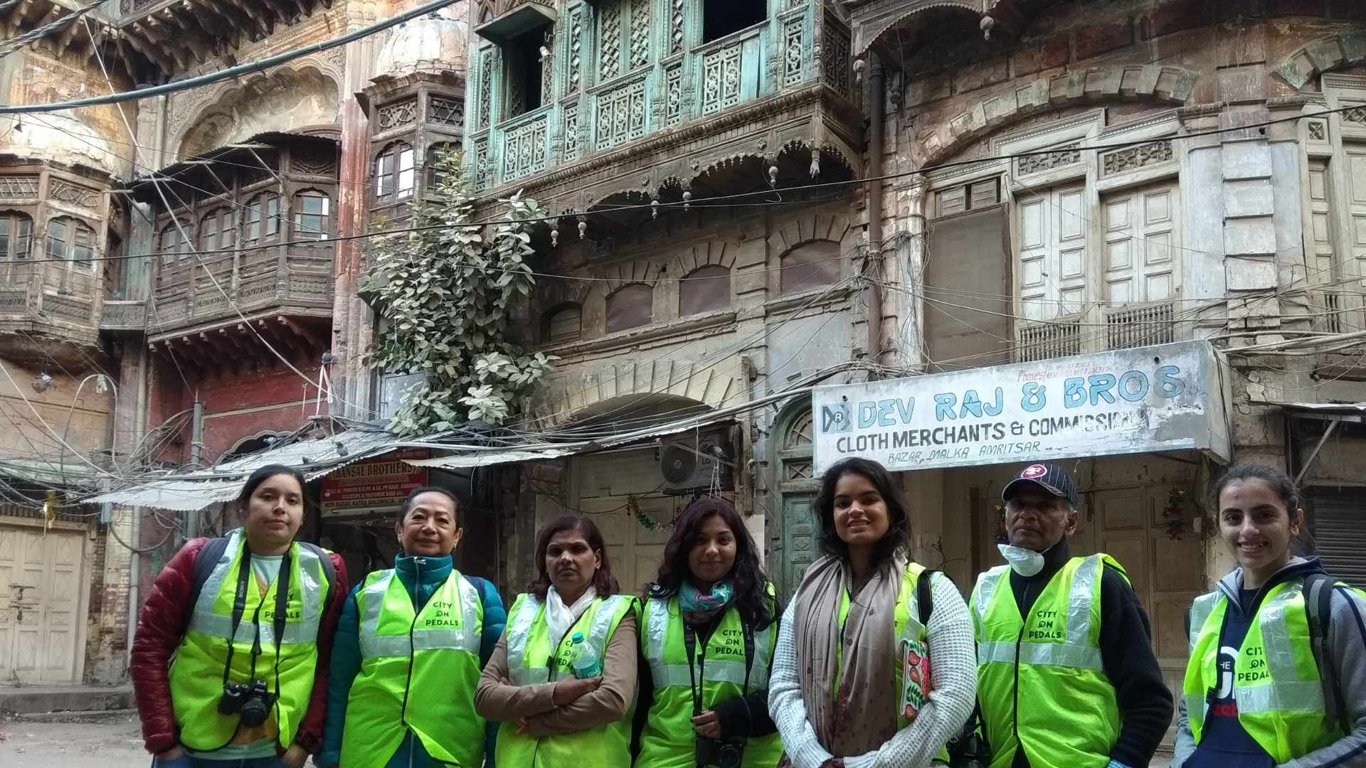 Mixed group of travelers in the narrow lanes of the walled city of Amritsar during the Amritsar Heritage Walking Tour