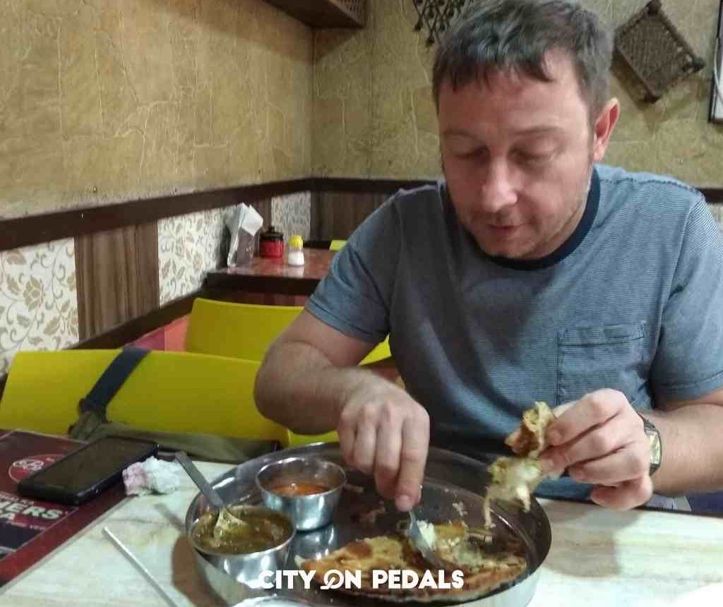 Traveler enjoying a traditional breakfast during the Amritsar Heritage Walking Tour