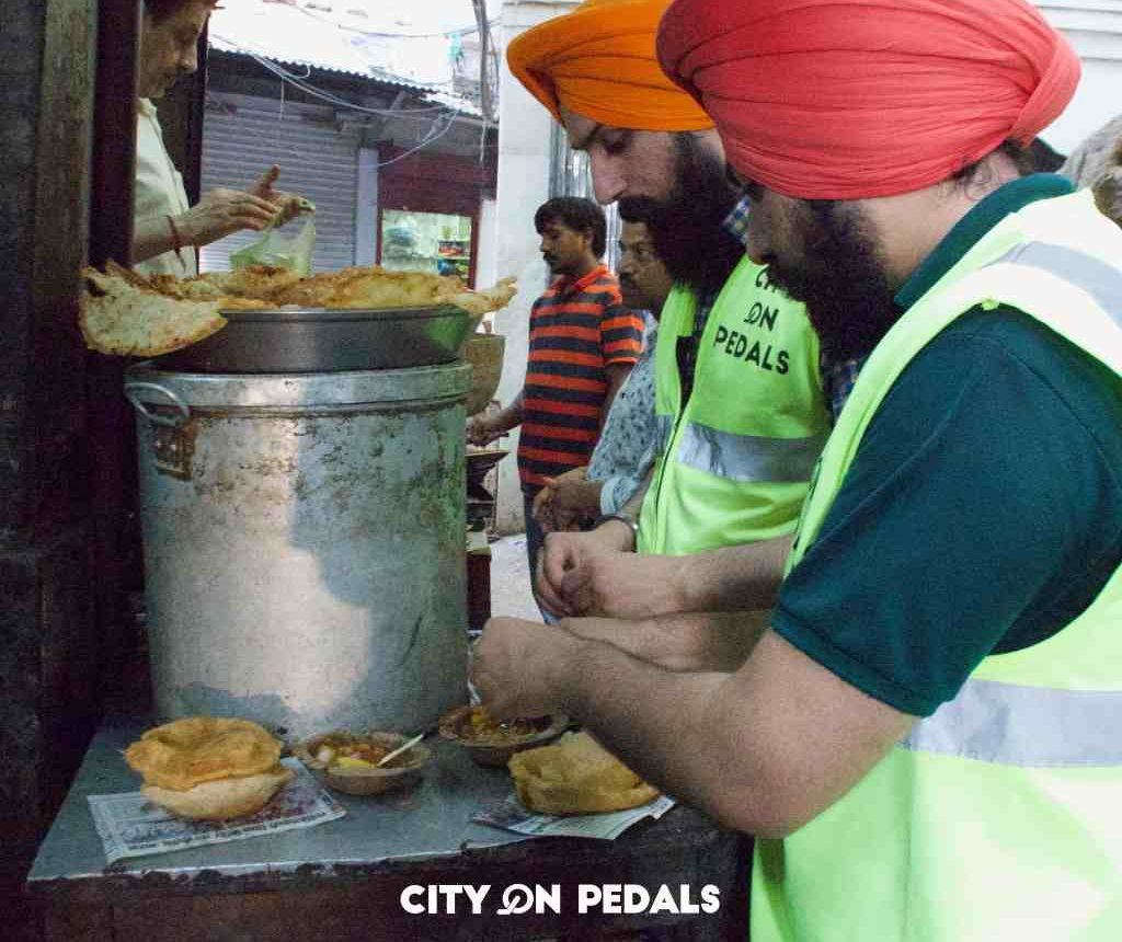 Travelers enjoying the street food of Amritsar during the Amritsar Heritage Walking Tour