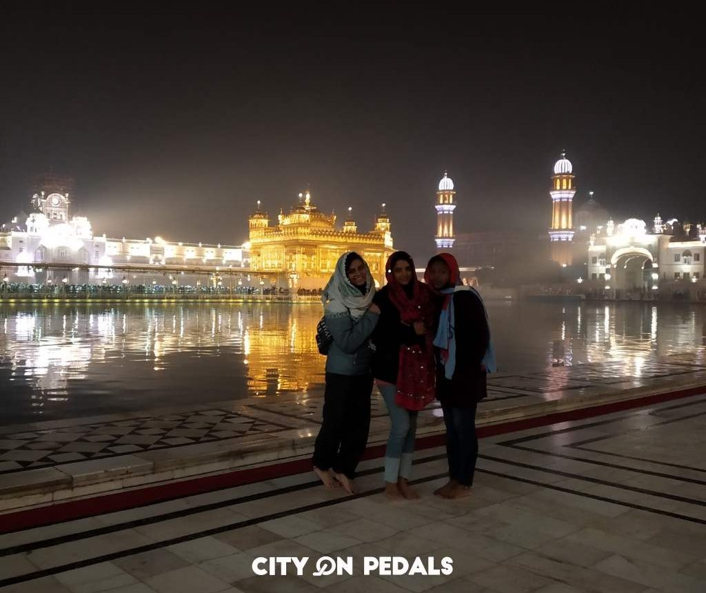 Female travelers during early morning Golden Temple visit