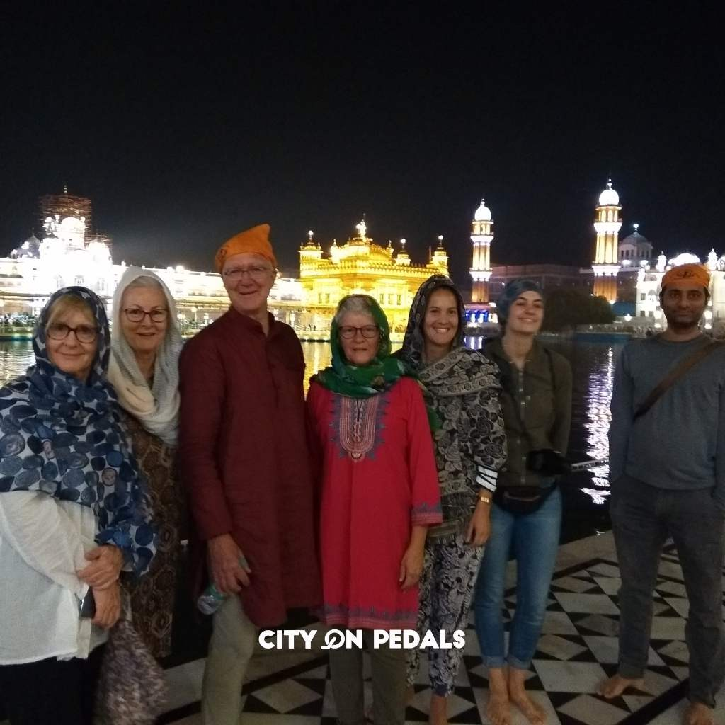 Mixed group of travelers at the Golden Temple