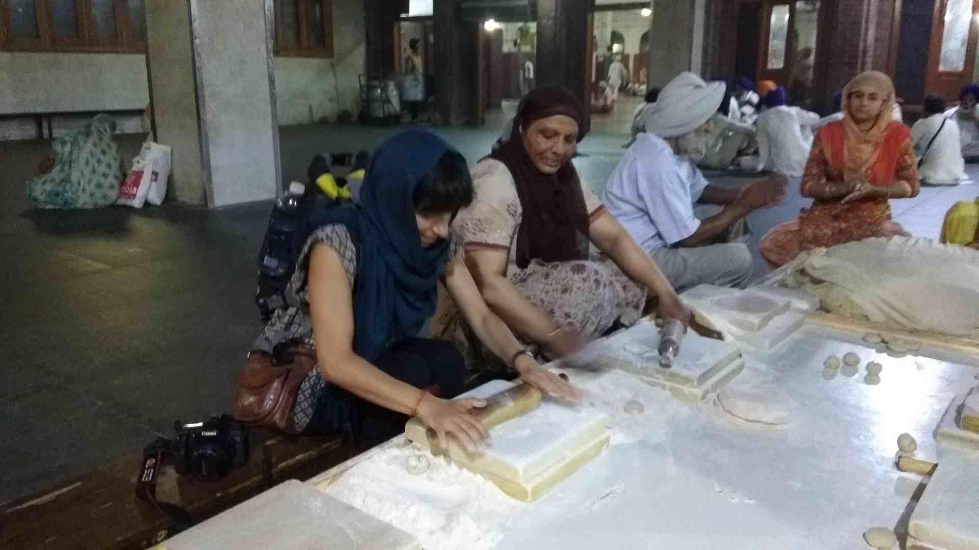 Traveler preparing roti inside the community kitchen