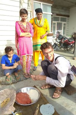 German traveler making rotis on Amritsar Village Tour