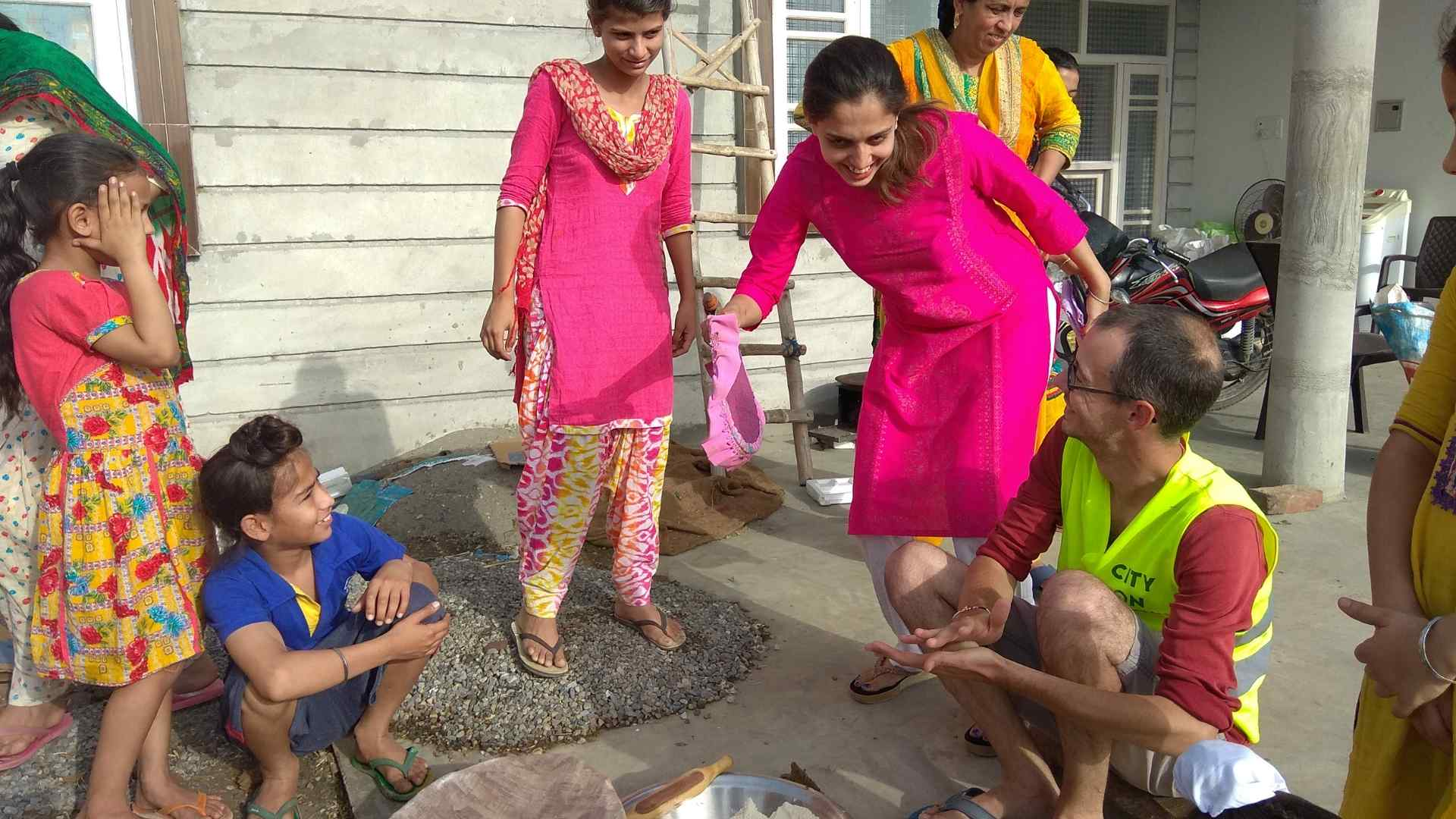 Preparing rotis on traditional chulha on village tour