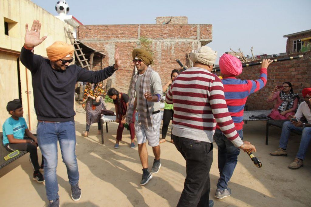 People enjoying Lohri by doing Bhagra