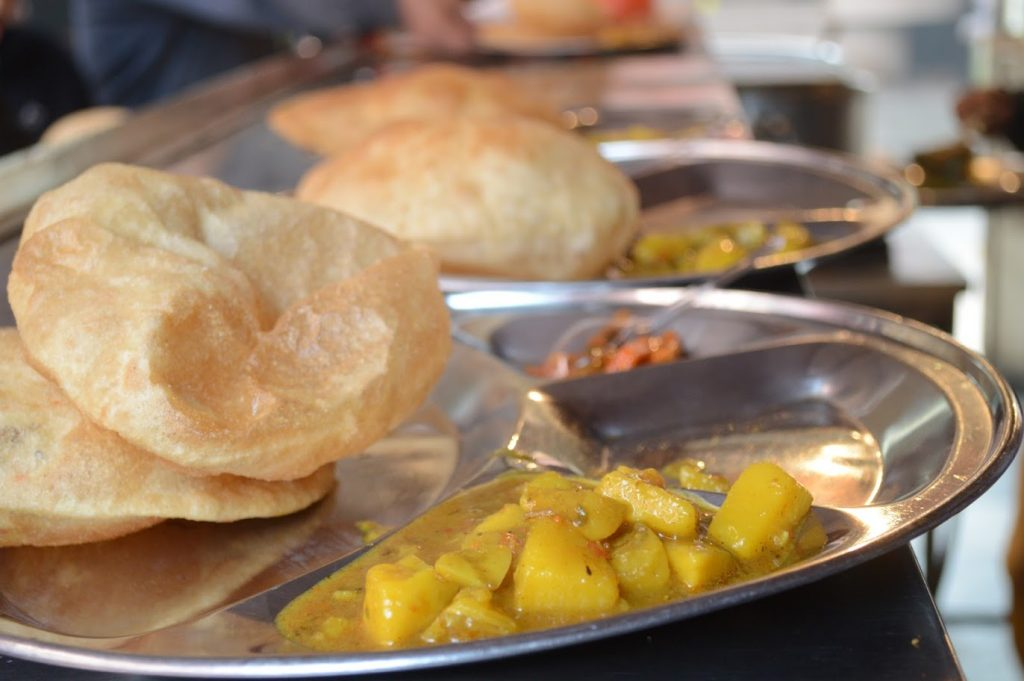 Poori Chane served with Potato Gravy